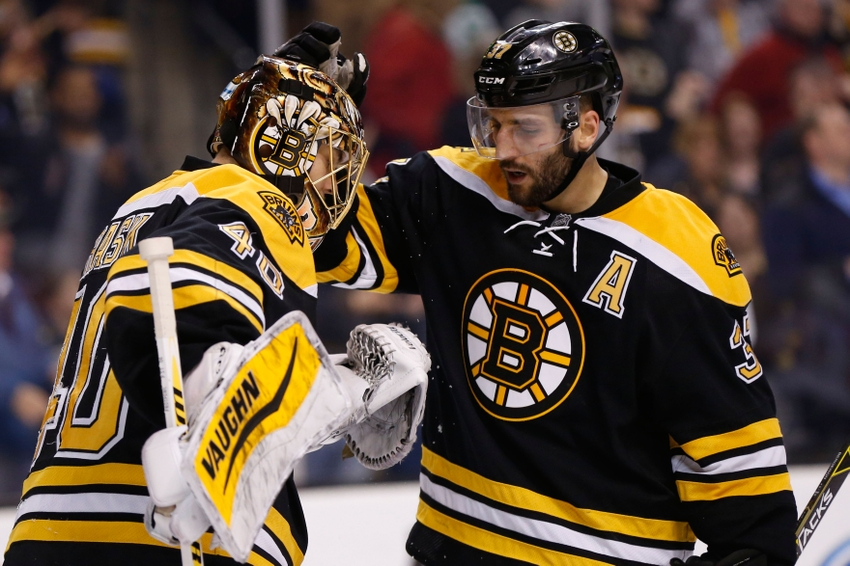 Mar 31, 2015; Boston, MA, USA; Boston Bruins center Patrice Bergeron (37) congratulates goalie Tuukka Rask (40) after defeating the Florida Panthers 3-2 at TD Banknorth Garden. Mandatory Credit: Greg M. Cooper-USA TODAY Sports