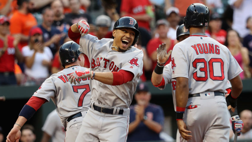 BALTIMORE, MD - MAY 31: Mookie Betts #50 of the Boston Red Sox (L) celebrates with Chris Young #30 after hitting a three run homer against the Baltimore Orioles in the second inning at Oriole Park at Camden Yards on May 31, 2016 in Baltimore, Maryland. (Photo by Rob Carr/Getty Images)